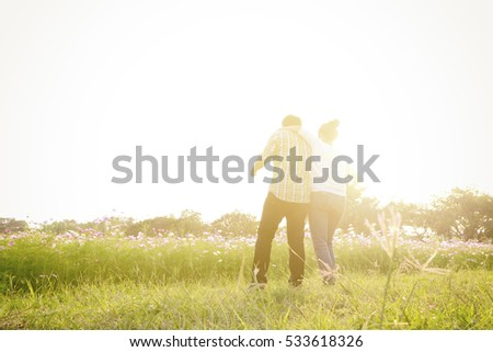 Young couple on the background of sunset