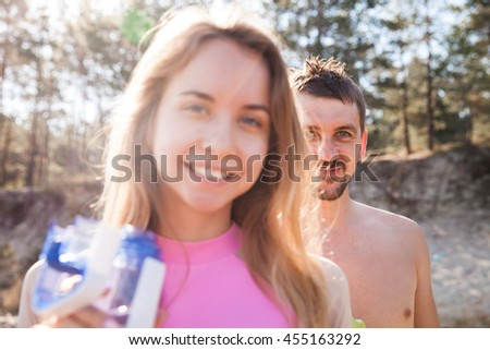 Young couple on the beach. Front view closeup - concept of harmony with the nature, free and healthy living, freelance, remote business. - stock photo