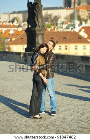 Young couple on the Charles Bridge - stock photo