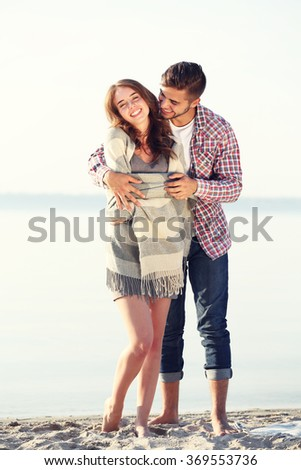 Young couple on the riverside - stock photo