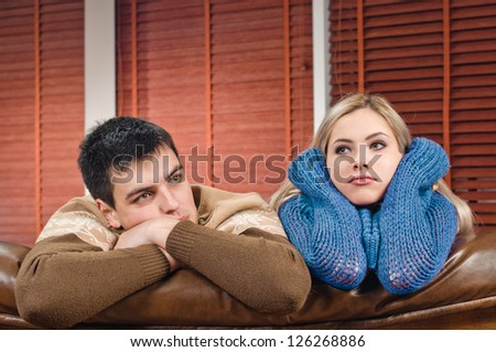 young couple on the sofa at the apartment - stock photo