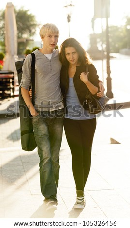 Young couple on the street of the city. - stock photo