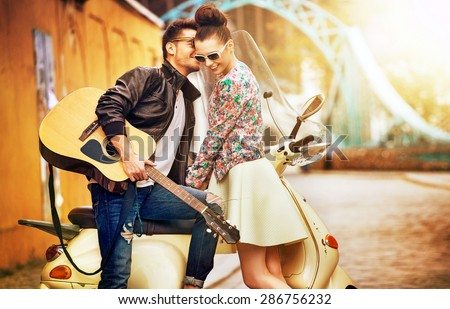 Young couple on the sunny street - stock photo
