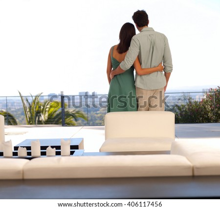 young couple on vacations on a balcony - stock photo