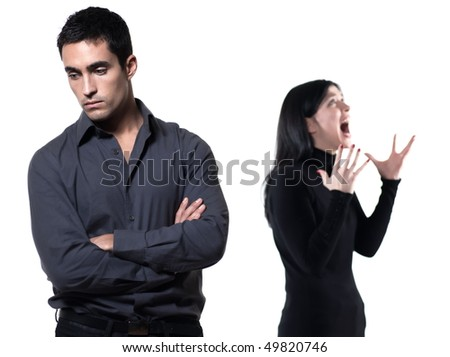 young couple on white background having a dispute - stock photo