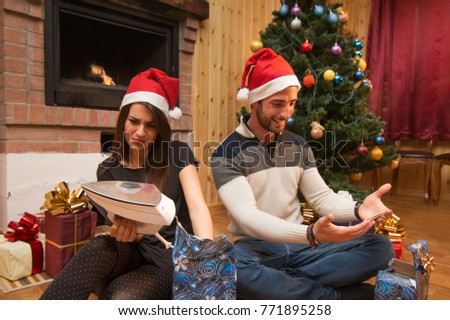 Young Couple Opening Christmas Gifts Under Stock Photo (Royalty Free ...