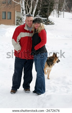 young couple outdoors with dog - stock photo