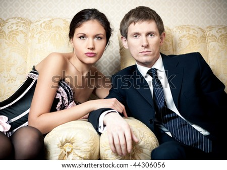 Young couple pensive indoors portrait. - stock photo