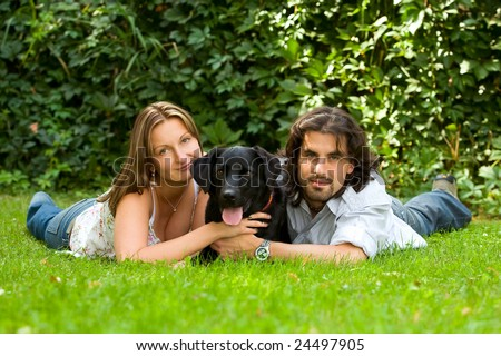 young couple people and dog - stock photo