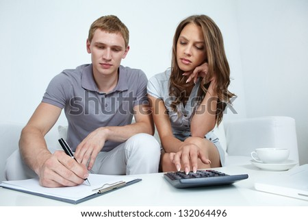 Young couple planning their budget - stock photo