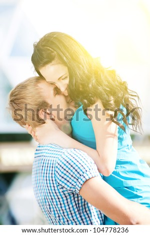 Young couple playing around in the nature - city park outdoor - stock photo
