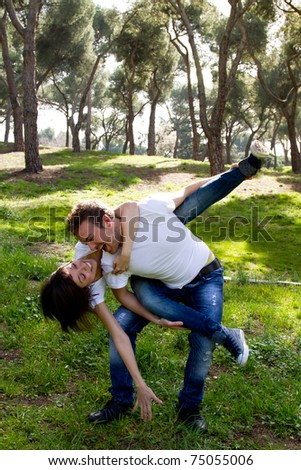 Young couple playing in the park