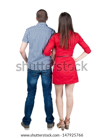 young couple pointing at wal Back view  (woman and man). looking into the distance. Rear view people collection.  backside view of person.  Isolated over white background. - stock photo