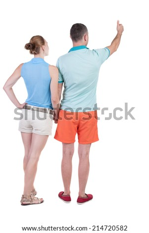 young couple pointing at wal Back view  (woman and man). Rear view people collection.  backside view of person.  Isolated over white background. - stock photo