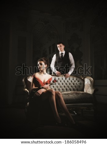 Young couple portrait with rose flower (ancient version) - stock photo