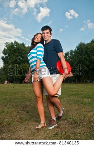 Young couple posing in park - stock photo