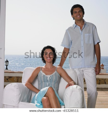 Young couple posing together - stock photo