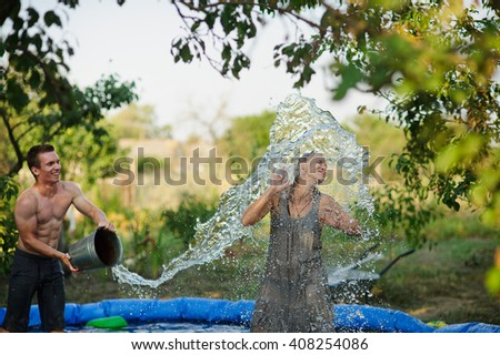 Young couple pours water and fun