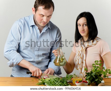 Young couple preparing vegetables