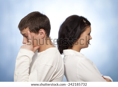 Young couple quarreling against a blue background  - stock photo
