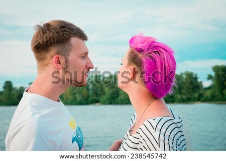 Young couple quarreling in the evening on the nature - stock photo