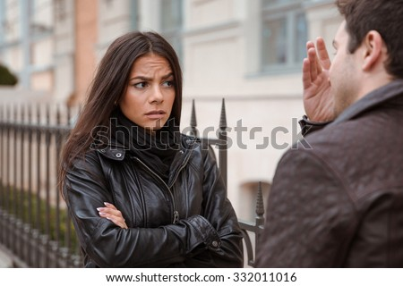 Young couple quarreling outdoors - stock photo