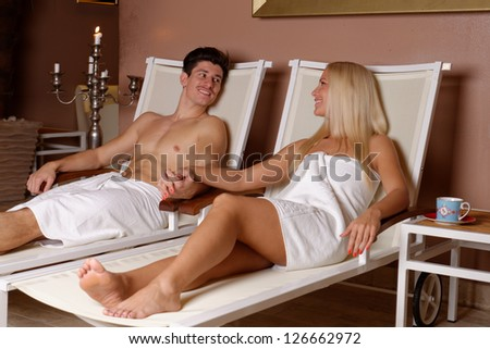 Young couple relaxing after sauna in Spa & Wellness center - stock photo