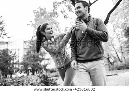 Young couple relaxing at the park,smiling and laughing. - stock photo