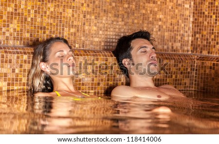 Young couple relaxing in a spa - stock photo