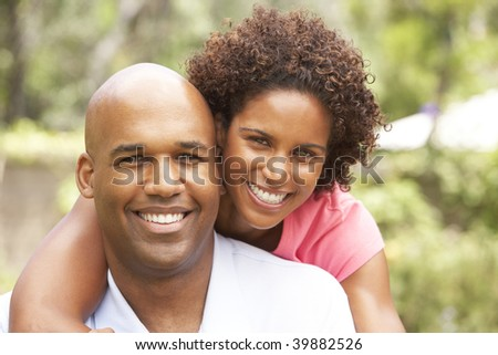 Young Couple Relaxing In Garden - stock photo