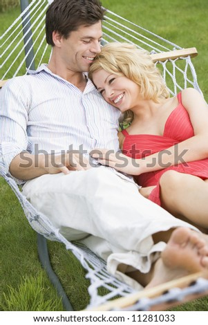 Young couple relaxing in hammock - stock photo