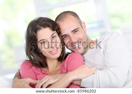 Young couple relaxing in sofa at home