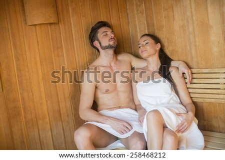 Young couple relaxing in the sauna - stock photo