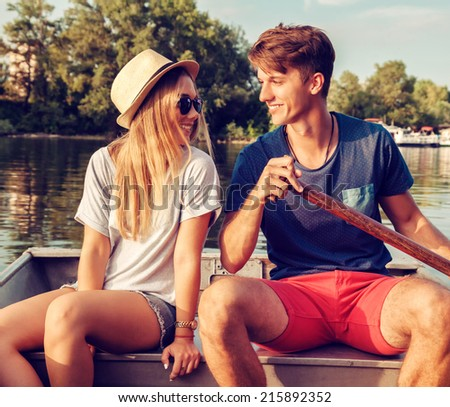 Young Couple Relaxing On A Boat Enjoying Sunny Day - stock photo