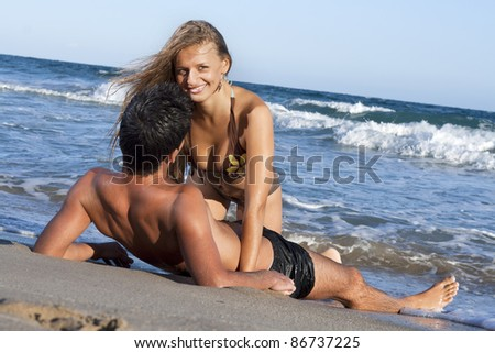 young couple relaxing on the beach