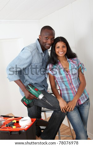 Young couple renovating their new house - stock photo