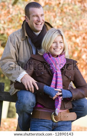 Young couple resting on autumn walk