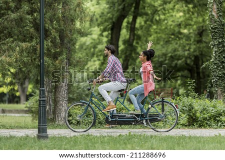 Young couple riding on the bicycle