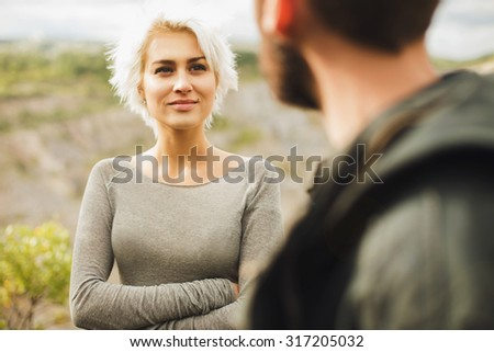 Young couple.romantic beautiful woman looks at man.boy and girl outdoor together - stock photo