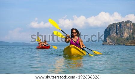 Young couple sea kayaking - stock photo