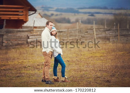 Young couple sharing a tender moment together while enjoying a day in the park - stock photo