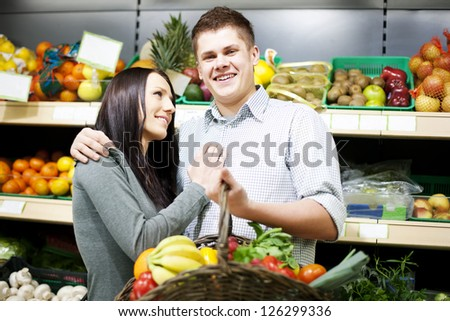 Young couple shopping at groceries - stock photo