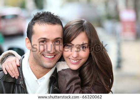 Young couple shopping in town in winter - stock photo