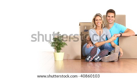 Young couple sitting on the floor after moving - stock photo