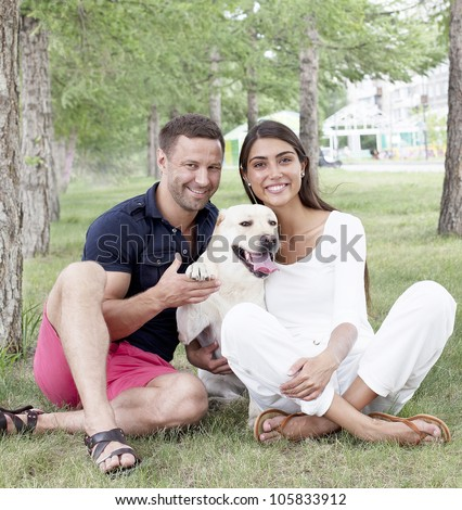 Young Couple sitting with Dog