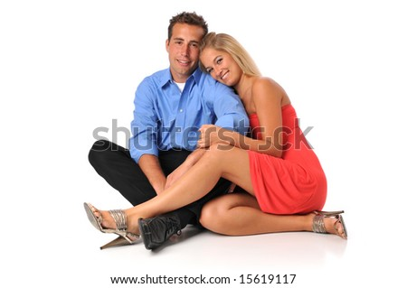 Young couple smiling against a white background