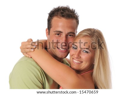 Young couple smiling and hugging isolated on a white background - stock photo