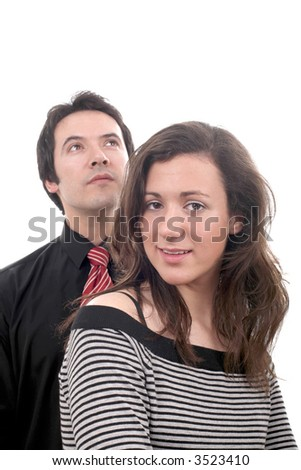 young couple smiling and standing next to each other - isolated over a white background... - stock photo