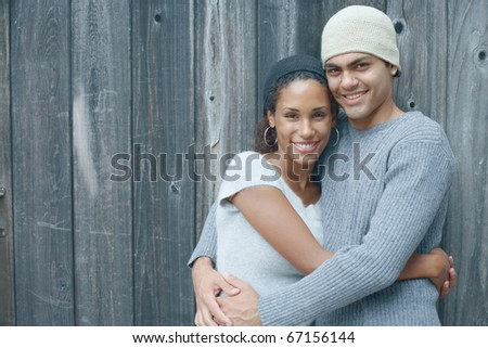 Young couple smiling for the camera - stock photo