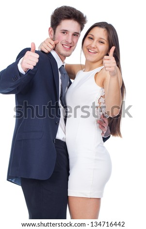 young couple smiling with thumbs up gesture - stock photo
